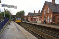 The station building at Urmston is no longer in railway use but is now a pub/restaurant 'The Steamhouse'. On the left a Northern Class 142 departs on the Hunts Cross to Oxford Road shuttle service on 20 October 2017.<br> Returning to the building on the westbound platform I was tempted to pay a visit because of the delightful smell coming from the kitchen but unfortunately on this occasion I had already eaten!<br><br>[John McIntyre&nbsp;20/10/2017]