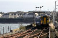 The 12.53hrs arrival at Stranraer Harbour on 26th October 2017. The signal box is switched out and all track, except to Platform 1, is very rusty indeed.<br> <br><br>[Colin Miller&nbsp;26/10/2017]
