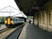 Looking north along platform 6 on the west side of Exeter St Davids station on on the morning of 30 June 2002. DMU 150267 is stabled alongside awaiting its next duty. <br><br>[Ian Dinmore&nbsp;30/06/2002]