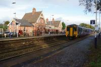 A Manchester to Liverpool via Warrington service calls at Irlam on 20 October 2017. The old station building has been renovated and now houses a small museum as well as the 'Café Bar 1923'. Further museum exhibits are situated in the garden area on the left.<br> <br> For a view of the station some 8 years ago before the changes [see image 25521]<br> <br><br>[John McIntyre&nbsp;20/10/2017]