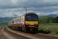 A pair of Class 320 units with 320307 leading, skirt the River Clyde approaching Brooks Road user worked LC between Ardmore East and Cardross on 28 May 2010. <br><br>[John McIntyre&nbsp;28/05/2010]