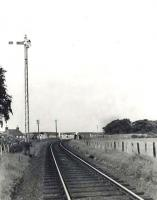 Looking east towards Banff at Inverboyndie level crossing on 23 August 1963. [Ref query 6 November 2017] <br><br>[G H Robin collection by courtesy of the Mitchell Library, Glasgow&nbsp;23/08/1963]