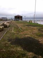 Some remaining track on the middle pier of Granton Harbour, seen on 31st<br> October 2017 looking north towards the Forth. The station was immediately behind<br> me, and ahead and to the left was a rail-served ice factory. I'm not sure what that surviving building was, but it was rail-served too.<br> <br> <br><br>[David Panton&nbsp;31/10/2017]