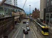 A recently installed footbridge offers an excellent viewpoint from which to watch the distant wall under Piccadilly station ingesting and ejecting trams. Main line trains can also be seen crossing the grey bridge in the distance.<br><br>[Ken Strachan&nbsp;29/07/2017]