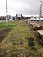 Although all traces of Granton Harbour station are long gone some track remains here on the middle pier. The station platform was where the roadway now is. The<br> area is now residential, the western part of the harbour (right) having mostly been filled in.  Looking south on 31st October 2017.<br> <br> <br><br>[David Panton&nbsp;31/10/2017]