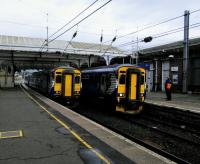 A delayed Stranraer service (right) changes crew at Ayr on 10 October. The train on Platform 3 (left) is not a northbound service but will form the next one southbound, to Girvan, in about 45 minutes.<br><br>[David Panton&nbsp;10/10/2017]