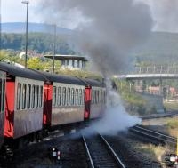 HSB 99 7240-7 departing Wernigerode with the 10:25 train to Brocken on 18 September 2017.  Wernigerode is 234 m above sea level, the station at the Brocken Summit is 1125 m above sea level, a climb of 891 metres in 34 kilometres, an average gradient of 1 in 38!  The communications tower and the air traffic control centre on the Brocken Summit are visible between the two lamp posts to the top left of the shot.  [See image 61125] for this train approaching the summit.<br><br>[Norman Glen&nbsp;18/09/2017]