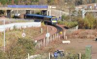 ScotRail 170395 has just cleared Whitehill Road Bridge shortly after restarting from Newcraighall station on 5 November 2017. The 1011 Edinburgh Waverley - Tweedbank is about to run onto the double track section at Newcraighall South Junction.<br><br>[John Furnevel&nbsp;05/11/2017]