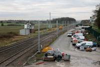 The scene at Salwick on 15th November 2017, five days into the Blackpool line closure. This has been an electrification work site for some time now. The signal box is still in place, although it will be demolished in due course, and the masts have now been erected. [See image 45862] for an earlier view of the same location.  <br><br>[Mark Bartlett&nbsp;15/11/2017]