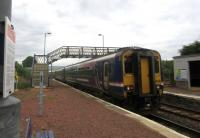 Glasgow bound at Breich showing the very low platforms but modern furniture, the closure notices and the empty surroundings. The village and its bus stop are a 15-minute walk away.<br><br>[John Yellowlees 27/06/2017]