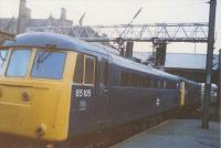 A double headed coal train passes through Preston Station in 1989. The front loco was 81017 and the second was 85105. Above them the signal shows a green aspect but also shows the letter F possibly indicating Fylde i.e. towards Blackpool? (Any further information would be appreciated.)<br><br>[Charlie Niven&nbsp;//1989]