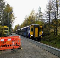 An Oban service calls at Tyndrum Lower on 1st November 2017. It's running late because of a delayed Up service and will in turn delay the next Up train here, then the one it joins at Crianlarich. Single lines, eh? Departure screens are being installed on the WHL, hence the ugly barriers.<br> <br> <br><br>[David Panton&nbsp;01/11/2017]