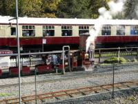 Train on the 7.25 inch circuit at the Conwy Valley Railway Museum passing one of the standard gauge Mk I coaches used for catering at the site. <br> <br> <br><br>[Peter Todd&nbsp;28/10/2017]