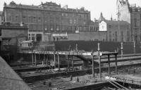 Looking over the parapet of Guild Street bridge in Aberdeen in March 1973 as the platform canopies and covered footbridge at the north end of the station are demolished.<br><br>[John McIntyre&nbsp;07/03/1973]