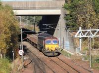Ballast arriving at Millerhill on 5 November 2017 behind 66077 about to enter the yard past Newcraighall North Junction. The train is the 0820 Perth - Millerhill SS.<br><br>[John Furnevel&nbsp;05/11/2017]