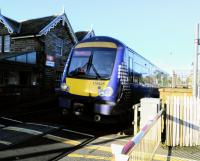 Up close and personal. An Edinburgh to Inverurie service pulls out of<br> Broughty Ferry and over the level crossing on 25th October 2017. The service here is not great, though better than the token one it had for many years. It suffers, like Invergowrie, for being a suburban location with no suburban service. Broughty Ferry and Invergowrie will have an hourly service from May 2019.<br> <br><br>[David Panton&nbsp;25/10/2017]