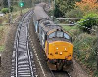37402 slows as it drops down the bank towards Lancaster Castle station with 2C47, 1004hrs Preston to Barrow-in-Furness, on a gloomy 31st October 2017. <br><br>[Mark Bartlett&nbsp;31/10/2017]