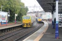 The Leaf Train on route to Airdrie passing a Milngavie service at Coatbridge Sunnyside.<br><br>[Alastair McLellan&nbsp;23/10/2017]
