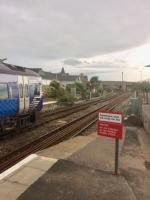 The 0900 Inverness to Aberdeen service, formed of two unidentified Class 158 units, waits to cross the 0819 Aberdeen to Inverness service at Elgin on 29th August 2017. Just before the bridge is the junction for the goods yard, formerly the connection to Elgin East (GNoSR) station. The junction was temporarily removed during the<br> engineering works a couple of weeks later.<br> <br> <br><br>[Caleb Abbott&nbsp;28/08/2017]