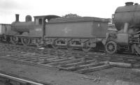 J21 0-6-0 no 65033 standing in the sidings at Heaton shed, buffered up to an accident damaged K3 2-6-0. Photograph thought to have been taken on 26 March 1961.<br><br>[K A Gray&nbsp;26/03/1961]