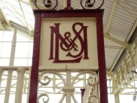 Here's a cartouche on Llandudno Station. Initially I thought it had to be the old LNWR, then a rethink was it the Manchester, Sheffield and Lincolnshire Rly? However second thoughts and a with deeper look I saw LM&S.<br><br>[Peter Todd&nbsp;27/10/2017]