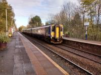 A 4-car service for East Kilbride calls at 'Shaws West on 11 November 2017.<br> 'Alight here for the... Pollok House' reads the sign, redacted during the temporary closure of the Burrel Collection.<br> <br> <br><br>[David Panton&nbsp;11/11/2017]