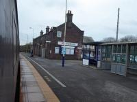 Corkickle station, now an unstaffed halt serving the south area of Whitehaven. The old station building is seen from a Cumbrian Coast train heading for Barrow-in-Furness in November 2017.   <br><br>[Mark Bartlett&nbsp;13/11/2017]