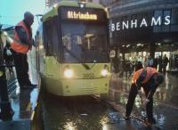 The driver of a tram for Altrincham dutifully cleans out flotsam which wild Manchester weather had deposited in the points. My wife, faced with an immobile tram, made a strategic decision to go shopping; we still caught our train home from Piccadilly.<br><br>[Ken Strachan&nbsp;21/10/2017]