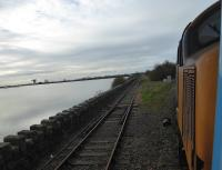 View of the Barrow Docks branch at Salthouse Junction from the 2C47 Preston to Barrow service on 13th November 2017. The line still sees traffic on an as required basis. This is primarily imported nuclear loads to be taken to Sellafield for reprocessing. <br><br>[Mark Bartlett&nbsp;13/11/2017]
