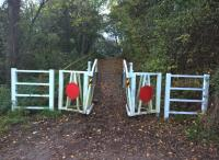 As Douglas Adams might have said: almost exactly, but not quite, level crossing gates. Ornamental entrance to the Weddington Railway Walk from Weddington Road.[see image 26581] for a winter view nearer to the Trent Vally main line.<br><br>[Ken Strachan&nbsp;28/10/2017]