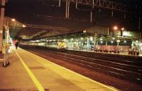 A southbound Inter City service, with a DVT leading, calls at Crewe on a late September evening in 1991.<br><br>[John McIntyre&nbsp;16/09/1991]