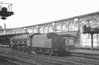 Royal Scot 46114 <I>Coldstream Guardsman</I> waits at signals alongside Carlisle platform 4 on 27 July 1963. The locomotive had recently arrived with a train from the south and was awaiting the clear to run back to Upperby shed.<br><br>[K A Gray&nbsp;27/07/1963]