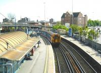 View south from the footbridge at Poole station on 3 May 2002 as a Weymouth - Waterloo train leaves plattform 1.<br><br>[Ian Dinmore&nbsp;03/05/2002]