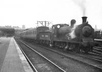 Ex-Caledonian 0-6-0 57630 prepares to take a local out of Buchanan Street in July 1949. <br><br>[G H Robin collection by courtesy of the Mitchell Library, Glasgow&nbsp;04/07/1949]