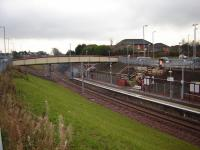 Merryton Station in Larkhall with piper at the official reopening of the Hamilton to Larkhall line - 9th December 2005.<br><br>[Gordon Steel&nbsp;09/12/2005]