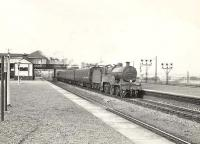 A St Enoch bound train from Ardrossan Winton Pier runs through Elserslie station on 14 September 1957 behind class 2P 4-4-0 40626. <br><br>[G H Robin collection by courtesy of the Mitchell Library, Glasgow&nbsp;14/09/1957]