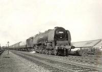 A Euston - St Enoch sleeper passing through Crossmyloof on 21 August 1957, hauled by Stanier ^Coronation^ Pacific no 46230 <I>Duchess of Buccleuch</I>.