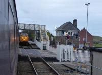 Class 37 hauled Cumbrian Coast services pass at St Bees on 13th November 2017. The substantial signal box controls the passing loop between the single line sections from Whitehaven and Sellafield, and the level crossing. <br><br>[Mark Bartlett&nbsp;13/11/2017]