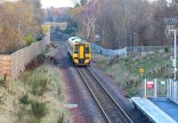 ScotRail 158741 passes the site of Hardengreen Junction [see image 17896] on 30 November 2017 with the 0924 Edinburgh - Tweedbank. The train is about to make its next scheduled stop at the 2015 Eskbank station. Visible beyond the smoke stained arch of the bridge in the background is the up platform of the original (1847-1969) station.<br><br>[John Furnevel&nbsp;30/11/2017]