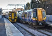 158721 on the 11.48 from Stirling to Edinburgh passes 380 004/114 on the 12.01 Edinburgh - Glasgow Queen Street, at Linlithgow.<br><br>[Bill Roberton&nbsp;10/12/2017]