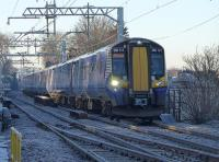 380 114 and 380 104 leave a sub-zero Linlithgow with the 11.00 Glasgow Queen Street service, on the first day of electric operation. <br><br>[Bill Roberton&nbsp;10/12/2017]