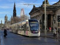 Tram 277, carrying 'Free trams on Hogmanay night' branding, heads east past the Royal Scottish Academy on 4th December 2017.<br> <br><br>[Bill Roberton&nbsp;04/12/2017]