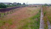 To the south of Dyce, on the west side of the line, was an extensive carriage shed and yard. By 1989 only this loading bank remained. Now not even this exists as the site has been redeveloped.<br><br>[Ewan Crawford&nbsp;//1989]