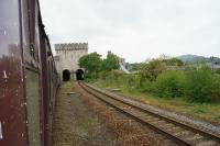 A view from the train of the eastern portal of the Conwy tubular bridge on 29 May 2013. The white splash marks on the carriage were courtesy of the Dollands Moor to Irvine china clay train that had pulled up alongside us at Warrington Bank Quay!<br><br>[John McIntyre&nbsp;29/05/2013]