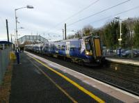 A North Berwick service pulls into Longniddry, on the cold morning of 9th<br> December 2017, while Christmas shoppers await the next Edinburgh train due in a<br> few minutes. Despite the single line branch from Drem Scotrail can easily<br> manage the half-hourly North Berwick service on Saturdays but it's only hourly Monday to Friday. Does anyone know the reason for this longstanding timetable oddity?<br> <br><br>[David Panton&nbsp;09/12/2017]