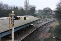The disconnected semaphore at Poulton still stands over the Down Line but not for much longer. This was the scene on 9th December 2017 with refurbishment work continuing on the island platform but no masts in the station area yet. [See image 39235] for the same location five years earlier.  <br><br>[Mark Bartlett&nbsp;09/12/2017]