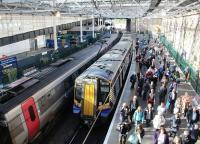 Passengers disembark at Waverley on a bright and sunny 5 October 2017. The train is the  0829 Ayr - Edinburgh, which has arrived here via Glasgow Central and Carstairs. Standing alongside at platform 19 is CrossCountry Trains ultimate long distance service, the 0820 Aberdeen – Penzance. <br><br>[John Furnevel&nbsp;05/10/2017]