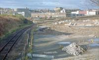 View of Kittybrewster in 1989. Oil sidings here had been lifted and the site was being redeveloped. <br> <br> Kittybrewster [1st], on the line down to Waterloo, was close to the camera and Kittybrewster [2nd], on the Denburn Valley line, was beyond on the main line. Before these, the first station here was a terminus called Aberdeen Kittybrewster.<br> <br> David Spaven comments 'there was a major domestic coal terminal here, served by hopper wagons. I was the Speedlink Coal manager responsible for shifting the coal handling activity down to Guild Street, immediately adjacent to the Russell (ex Freightliner) intermodal terminal, with coal arriving from Yorkshire and South Wales by container. The Baker Atlas for 1988 shows Ellis & McHardy Coal Depot, Lime and LPG Terminals.'<br> <br><br>[Ewan Crawford&nbsp;03/11/1989]