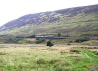 The mid afternoon southbound ScotRail service on the far north line, having recently left Rogart heading for Lairg in the summer of 2007. [Ref query 18 December 2017]<br><br>[John Furnevel 30/08/2007]