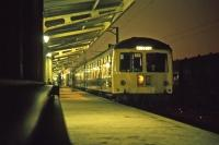 On Sunday 14th November 1976 at around 21.00, the last return trip of the day to Sudbury is about to head off into the night from platform 6 at Colchester.<br><br>[Mark Dufton&nbsp;14/11/1976]